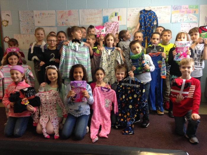 3rd grade students with their pajama donations.